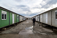 ATHENS, GREECE - FEBRUARY 05: A refugee walks inside the Eleonas refugee camp on February 05, 2015 in Athens, Greece. Hundreds of refugees are transferred every day to Eleonas refugee camp while waiting to travel to the Macedonian border. Photo: © Omar Havana. All Rights Are Reserved