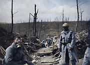 """Colorized photographs soldiers from the World War One<br /> <br /> With his impressive colorized photographs of the World War One, Frédéric Duriez gives us a new look at the conflict that ravaged the world between 1914 and 1918, revealing the difficult daily life of the French soldiers. <br /> <br /> Photo Shows: """"Wood of the Caillette - 1916 - Soldier trying a German mask found on the ground<br /> ©Frédéric Duriez/Exclusivepix Media"""