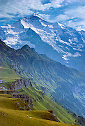 """From Männlichen, see Jungfrau (""""The Virgin"""" 4158 meters or 13,642 feet elevation) and Lauterbrunnen Valley in the Berner Oberland, Switzerland, the Alps, Europe. UNESCO lists """"Swiss Alps Jungfrau-Aletsch"""" as a World Heritage Area (2001, 2007). The Bernese Highlands are the upper part of Bern Canton, Switzerland. Published in Wilderness Travel Catalog of Adventures 1995, 1991."""