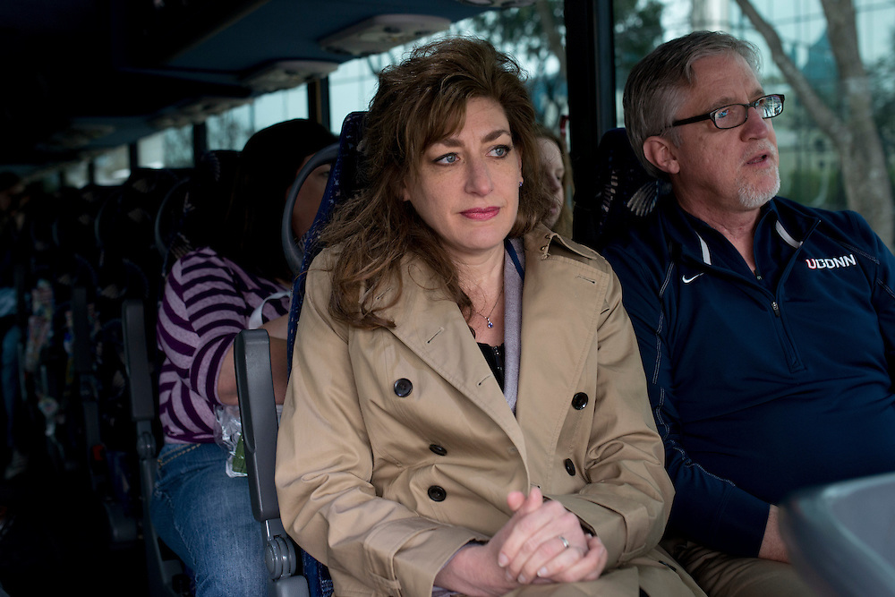 UConn President Susan Herbst sits next to her husband, Doug Hughes, as they wait to leave the Hyatt Regency in Dallas, Texas to watch her school compete in the NCAA Final Four on April 5, 2014. (Cooper Neill / for The New York Times)