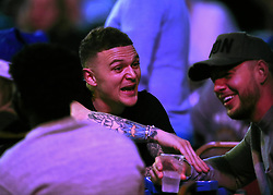 Tottenham player Kieran Trippier jokes with a friend as they watch the action during day three of the William Hill World Darts Championships at Alexandra Palace, London.