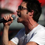 Pat Monahan of the Grammy award winning band Train sings during a one hour performance prior to the start of the NASCAR Coke Zero 400 race at Daytona International Speedway in Daytona Beach, Fl., on Saturday July 7, 2012. (AP Photo/Alex Menendez)