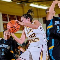 012514       Cable Hoover<br /> <br /> Tohatchi Cougar Hevyn Crawford (32) grabs a rebound away from Navajo Prep Eagle Hannah Antone (22) Saturday at Tohatchi High School.