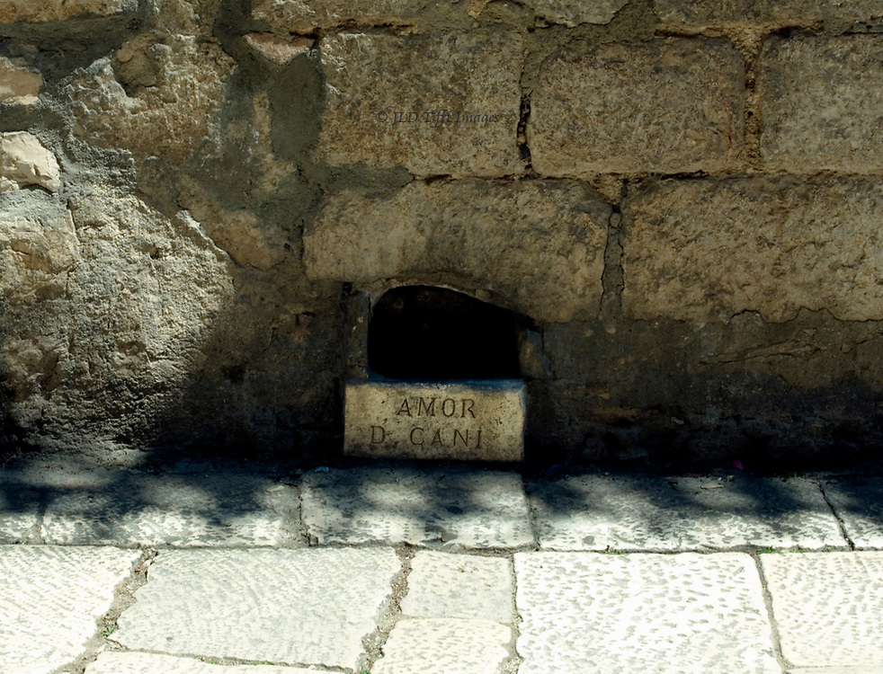 """Sibenik, water dish for dogs built into a Renaissance wall, inscribed """"AMOR D' CANI"""""""