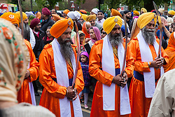 Slough, UK. 28th April 2019. The Pani Pyare (Five Beloved Ones) take part in the Vaisakhi Nagar Kirtan procession from the Gurdwara Sri Guru Singh Sabha to the Ramgarhia Sikh Gurdwara. Vaisakhi is the holiest day in the Sikh calendar, a harvest festival marking the creation of the community of initiated Sikhs known as the Khalsa.