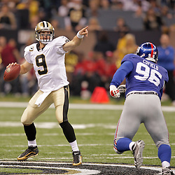2009 October 18: New Orleans Saints quarterback Drew Brees (9) is rushed by New York Giants defensive tackle Barry Cofield (96) during a regular season game between the New Orleans Saints and the New York Giants at the Louisiana Superdome in New Orleans, Louisiana.