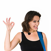 Smiling Female guitarist gives the OK sign