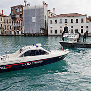 VENICE, ITALY - JANUARY 16: A Police power boats tries to stop a boat with protesters on the day of the special meeting discussing the environmental impact of cruises in St Mark's basin on January 16, 2012 in Venice, Italy. Protest are mounting in Venice against large cruise ships crossing St Marks's basin after the Costa Concordia tragedy.