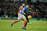 Portsmouth defender Nathan Thompson (20) and Sunderland forward Jerome Sinclair (17) during the EFL Sky Bet League 1 match between Portsmouth and Sunderland at Fratton Park, Portsmouth, England on 22 December 2018.