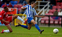 Photo: Alan Crowhurst.<br />Welling United v Clevedon Town. The FA Cup Qualifying. 28/10/2006. Mitchell Page of Clevendon (R) scores the third goal 0-3.
