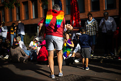 © Licensed to London News Pictures . 27/08/2021. Manchester, UK. LILLY-ANNE PHEASEY (six) laughs as her mother EMMA PHEASEY (40) spins her around to music being played on Canal Street . People are seen out celebrating in and around Manchester's Gay Village during the city's annual Gay Pride festival . The event was cancelled in 2020 due to Coronavirus . Manchester Pride charity has been criticised after it withdrew funding for the LGBT Foundation's condom distribution scheme and withdrew support for HIV charity George House Trust over GHT's support for HIV positive people of all sexualities . Manchester Pride chief executive Mark Fletcher has received a £20,000 pay rise over the last two years and now earns between £90,000 and £100,000 . Photo credit: Joel Goodman/LNP