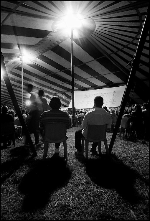 """Marville, 2002 - 40,000 Gypsies from all over the world come together and pray in Marville, a little village in France. They encanped in a former air base of NATO during 1 week. """"Vie et Lumiere"""" is an International Evangelic Community  ©Jean-Michel Clajot"""