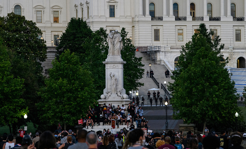 DC protesters gather around the Peace Monument in front of the Capitol Building, The protesters see a calmer night as they marched from the white house to the capitol defying the curfew.