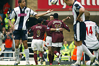 Photo: Chris Ratcliffe.<br />Arsenal v West Bromwich Albion. The Barclays Premiership. 15/04/2006.<br />Robert Pires of Arsenal celebrates his goal with Jose Antonio Reyes and Emmanuel Adebayor, as West Brom players are gutted.