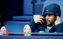 Manchester City's Riyad Mahrez sits on the bench during the Premier League match at the Etihad Stadium, Manchester.