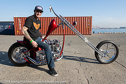 Hawke Lawshe with his custom 1946 Harley-Davidson Knucklehead chopper at the docks early on setup day for the