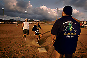 Baseball game by the US Fire Department, 27th May 1997, on Ascension, a small area of approximately 88 km² isolated volcanic island in the equatorial waters of the South Atlantic Ocean, roughly midway between the horn of South America and Africa. It is governed as part of the British Overseas Territory of Saint Helena, Ascension and Tristan da Cunha. Organised settlement of Ascension Island began in 1815, when the British garrisoned it as a precaution after imprisoning Napoleon I on Saint Helena. In January 2016 the UK Government announced that an area around Ascension Island was to become a huge marine reserve, to protect its varied and unique ecosystem, including some of the largest marlin in the world, large populations of green turtle, and the islands own species of frigate bird. With an area of 234,291 square kilometres 90,460 sq mi, slightly more than half of the reserve will be closed to fishing.