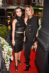 Left to right, Amy Jackson and Kimberley Garner at a private view of work by Bradley Theodore entitled 'The Second Coming' at the Maddox Gallery, 9 Maddox Street, London England. 19 April 2017.
