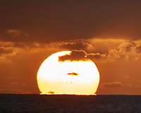 Sunrise from the deck of the MV World Odyssey. Image taken with a Nikon One V3 camera and 70-300 mm VR lens (ISO 200, 300 mm, f/5.6, 1/250 sec, -1 EV). Field of View equivalent to an 810 mm lens on a 35 mm sensor camera.