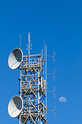microwave and mobile radio antennas on tower with moon in background on Mt Stuart, Townsville, Queensland, Australia <br /> <br /> Editions:- Open Edition Print / Stock Image