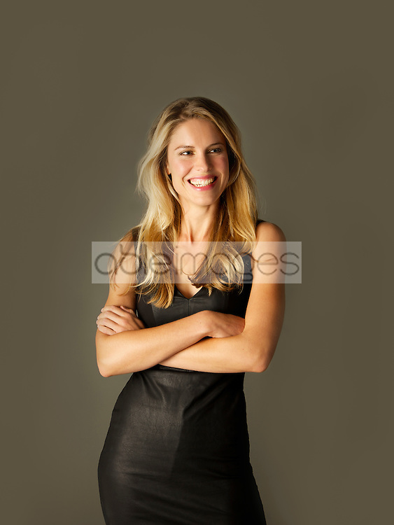 Attractive Blonde Woman with Arms Crossed Smiling