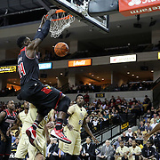 Louisville Cardinals forward Montrezl Harrell (24) slams the ball during the first period during an NCAA basketball game between the 14th ranked Louisville Cardinals and the UCF Knights at the CFE Arena on Tuesday, December 31, 2013 in Orlando, Florida. (AP Photo/Alex Menendez)