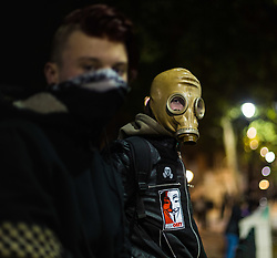 London, November 05 2017. Anti-capitalists gather in Trafalgar Square, London for the annual 'Million Mask March' which happens on November 5th every year, with many of the protesters donning 'V' For Vendetta Guy Fawkes masks. Past marches have turned violent with police horses shot by fireworks and police vehicles burned. PICTURED: Two masked protesters on Whitehall. © Paul Davey