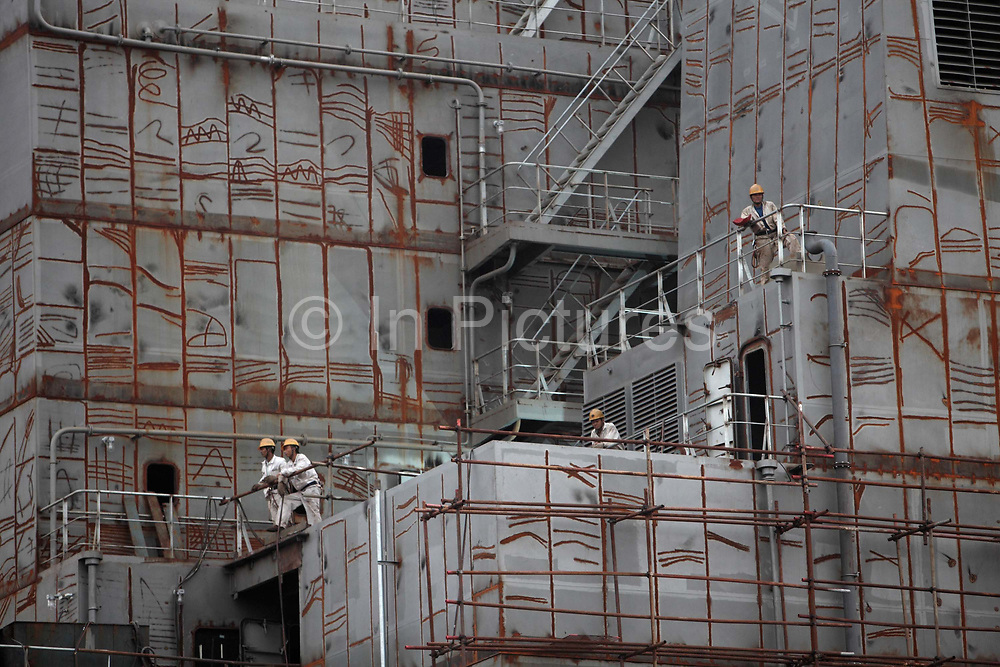 Workers repairs a ship at the China CSSC Holdings Ltd. Chengxi Shipyard in Jiangyin, China, on Sunday, Sept. 12, 2010. China CSSC Holdings Ltd., the nation's biggest shipyard, sees orders surge as China's voracious appetite for commodities demands more fleets of large vessels.