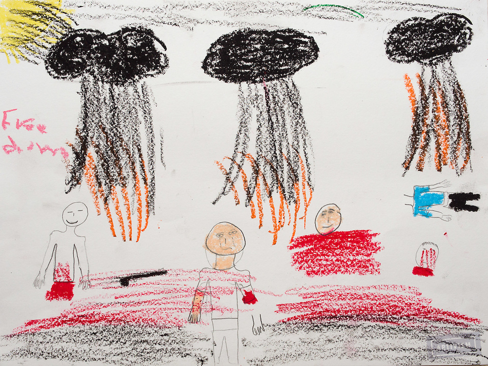"""""""Three bombs dropping on Syria, as people lose legs, arms, body parts. The whole sky is black."""" Drawing by Syrian girl, age 13. (Topic for this session: dealing with loss.)"""