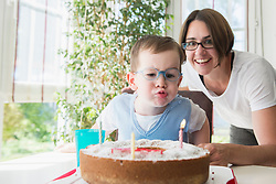 Mother and son blowing birthday candles, Bavaria, Germany