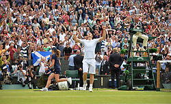 © London News Pictures.. 03/07/2013. Andrew Murray celebrates after defeating Fernando Verdasco, Spain in the men's quarter finals at the 2013 Wimbledon Lawn Tennis Championships . Andy Murray went on to win in the final becoming the first British male to win the tournament in 77 years. Photo credit: Mike King/LNP