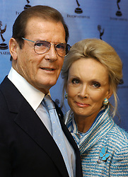 File photo dated 19/11/01 of Sir Roger Moore and his wife Christina. Sir Roger has died in Switzerland after a short battle with cancer, his family has announced.