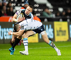Hanno Dirksen of Ospreys is tackled by Josh Adams of Cardiff Blues<br /> <br /> Photographer Simon King/Replay Images<br /> <br /> Guinness PRO14 Round 8 - Ospreys v Cardiff Blues - Saturday 21st December 2019 - Liberty Stadium - Swansea<br /> <br /> World Copyright © Replay Images . All rights reserved. info@replayimages.co.uk - http://replayimages.co.uk