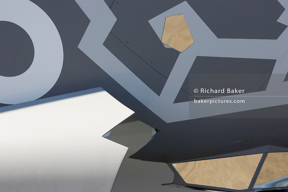 Detail of stealth technology surfaces on a Lockheed-Martin F-35 II Joint Strike Fighter at the Farnborough Air Show, England. The Lockheed Martin F-35 Lightning II is a family of single-seat, single-engine, fifth-generation multirole fighters under development to perform ground attack, reconnaissance, and air defense missions with stealth capability. F-35 JSF development is being principally funded by the United States with additional funding from partners. The partner nations are either NATO members or close U.S. allies.