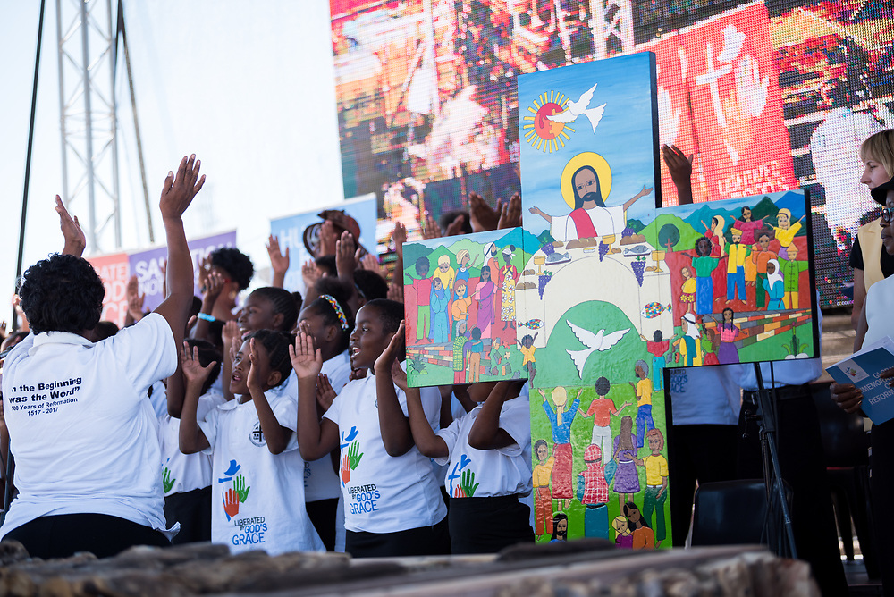 """14 May 2017, Windhoek, Namibia: The Salvadoran cross, designed for the joint Catholic-Lutheran Commemoration of the Reformation in October 2016, has made the journey to Namibia, in time for the Lutheran World Federation's Twelfth Assembly. Thousands of Lutherans and guests gathered for a festival of worship, witness and song and word and sacrament in Sam Nujoma Stadium on Sunday, May 14th to mark commemoration of the 500th Anniversary of the Lutheran Reformation in Windhoek, Namibia. Marking the Reformation as global citizen, the worship event drew music, stories, and leadership from the churches of every continent. The service formed a high point of the Twelfth Assembly of the Lutheran World Federation, in Windhoek, Namibia, on 10-16 May 2017, under the theme """"Liberated by God's Grace"""", bringing together some 800 delegates and participants from 145 member churches in 98 countries."""