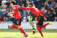 Peter Whittingham collects the ball from the goal and is congratulated by Fraizer Campbell after scoring the equaliser from the penalty spot. Barclays Premier league match, Cardiff city  v Stoke city at the Cardiff city stadium in Cardiff, South Wales on Saturday 19th April 2014. pic by Mark Hawkins, Andrew Orchard sports photography,