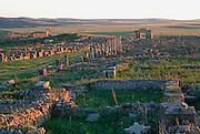 MOROCCO, ROMAN HISTORY Volubilis, 1-3C AD, Roman city in the Roman province of Mauretania Tingitana; view of Caracalla's Arch and town site