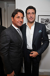Left to right, GIORGIO VERONI and EDUARDO TEODORANI-FABBRI at a private view of photographs by Marina Cicogna from her book Scritti e Scatti held at the Little Black Gallery, 3A Park Walk London SW10 on 16th October 2009.