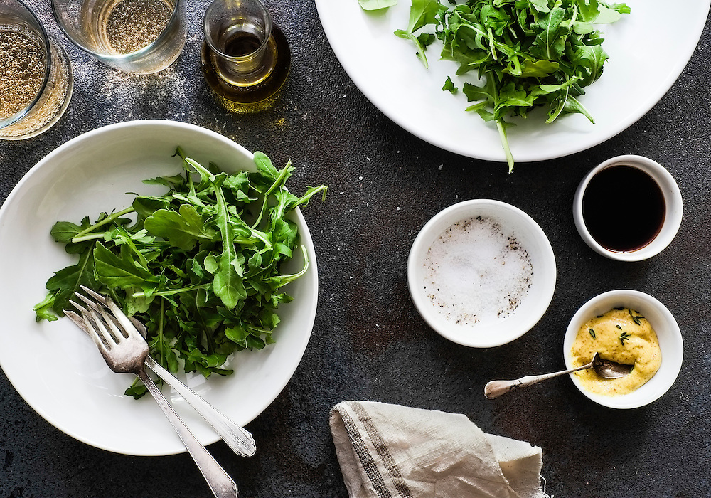 Arugula salad about to be tossed with balsamic and extra virgin olive oil.