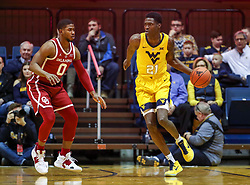 Feb 2, 2019; Morgantown, WV, USA; West Virginia Mountaineers forward Wesley Harris (21) dribbles while defended by Oklahoma Sooners guard Christian James (0) during the first half at WVU Coliseum. Mandatory Credit: Ben Queen-USA TODAY Sports