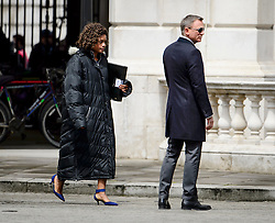 """© Licensed to London News Pictures. 30/05/2015. London, UK. . Filming for the new James Bond film """"Spector"""" with Daniel Craig (right) and Naomie Harris (left) at the courtyard of the UK Government Treasury building in Westminster, London . Photo credit: Ben Cawthra/LNP"""