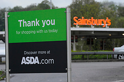 © Licensed to London News Pictures. 28/04/2018. LONDON, UK.  Signage for an ASDA and Sainsbury's superstore are seen opposite each other in Watford, north west London.   ASDA and Sainsbury's are reported to be in negotiations for a GBP10m merger to create combined group of 2,800 stores representing over 30% of the UK grocery market.  Photo credit: Stephen Chung/LNP