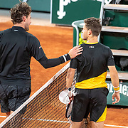 PARIS, FRANCE October 06. Dominic Thiem of Austria congratulates winner Diego Schwartzman of Argentina as they meet at the net after the Quarter Finals of the singles competition on Court Philippe-Chatrier during the French Open Tennis Tournament at Roland Garros on October 6th 2020 in Paris, France. (Photo by Tim Clayton/Corbis via Getty Images)