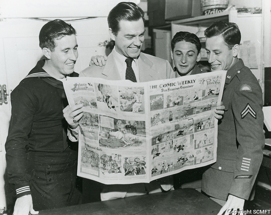1944 Actor Philip Terry reads the comics with visiting servicemen at the Hollywood Canteen