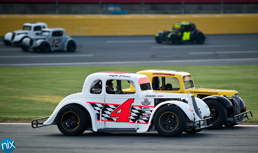 Steven Cantrell (28) leads Kyle Plott (4) during the pro division feature of the Summer Shootout Series final at Charlotte Motor Speedway Tuesday night. (Photo by James Nix)