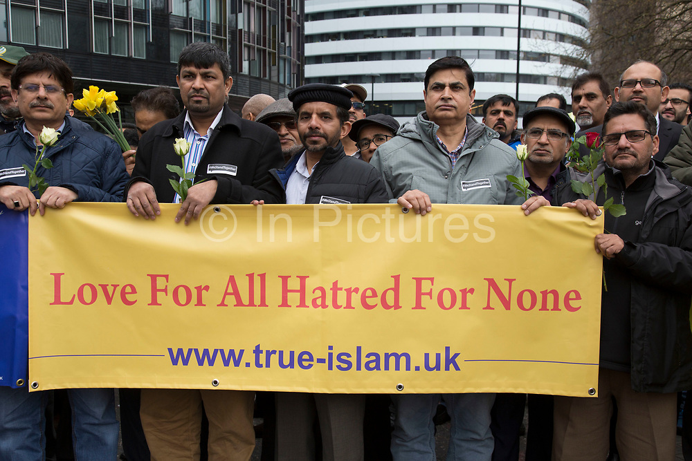 Thousands of people including police officers and Muslim faith leaders gathered on Westminster Bridge to hold a vigil and a minutes silence one week after the terror attack, on March 29th 2017 in London, United Kingdom. Muslim men with banners which read; Love for all hatred for none.