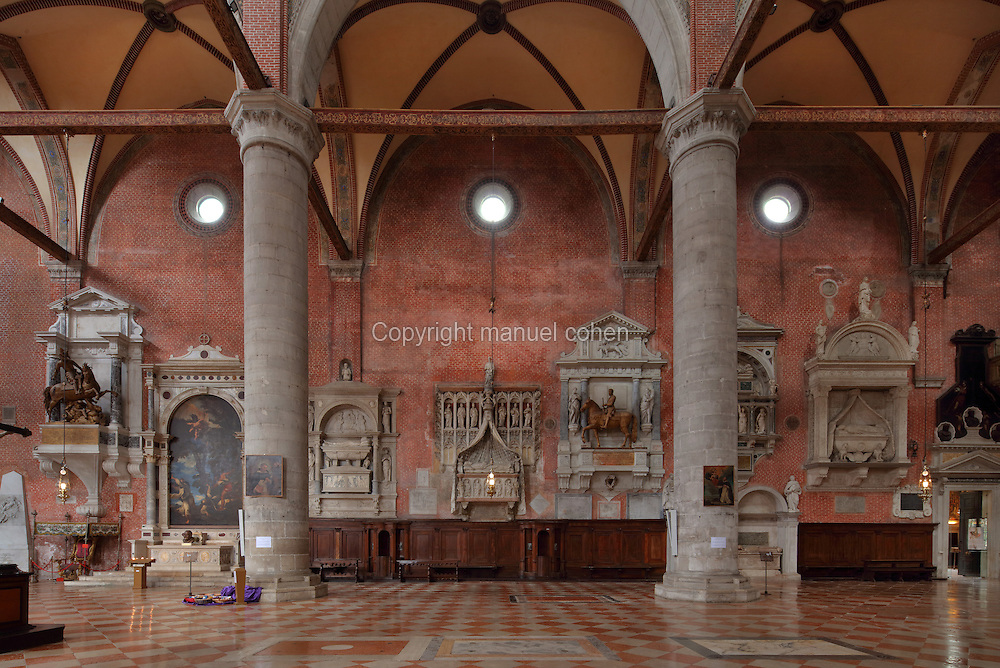 Tombs of Doges on the walls of the Basilica of San Giovanni e Paolo, built 1430s in Italian Gothic style, Venice, Italy, with medieval and Renaissance wall tombs. The church is dedicated to 2 early Christian martyrs, John and Paul. 25 Doges have been buried here since the 15th century. The city of Venice is an archipelago of 117 small islands separated by canals and linked by bridges, in the Venetian Lagoon. The historical centre of Venice is listed as a UNESCO World Heritage Site. Picture by Manuel Cohen