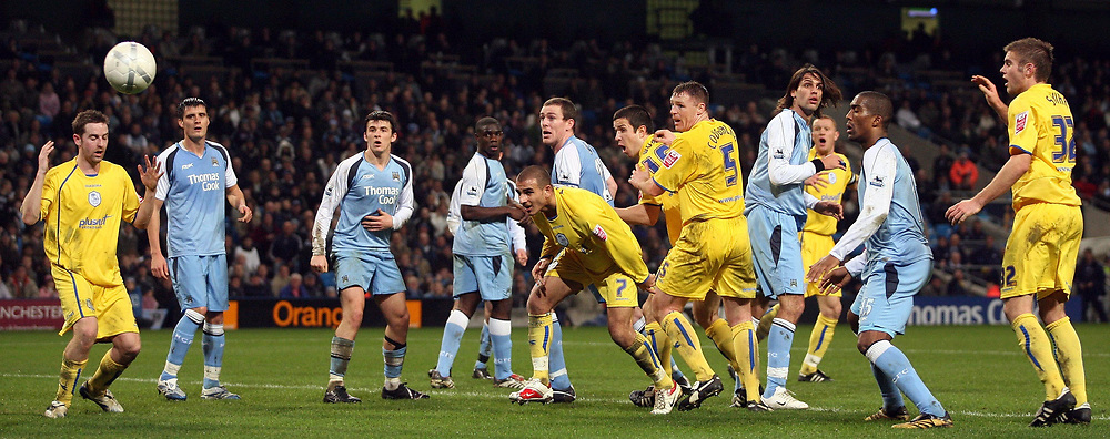 Photo: Paul Thomas.<br /> Manchester City v Sheffield Wednesday. The FA Cup. 16/01/2007.<br /> <br /> Both team watch this header go very close to giving Wednesday (Yellow) the equaliser they needed to force extra time.