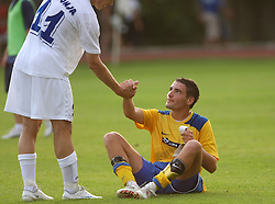 Etien Velikonja of Gorica helps Aleksander Rajcevic of Koper after 2nd Round of PrvaLiga Telekom Slovenije between NK Koper vs NK Hit Gorica, on July 26, 2008, in SRC Bonifika stadium in Koper. Gorica won the mach 3:1. (Photo by Vid Ponikvar / Sportal Images)