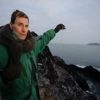 "NORTH BERWICK, UK - 6th March 2010:  Mystifier Uri Geller sets foot on Lamb island, a tiny island which is believed to be connected with the Great Pyramids of Giza, in search of treasure left behind by an exiled Egyptian Princess ""Scota"".  Uri bought the tiny island which is situated just off North Berwick, in the Firth of Forth after his friend Mohammed Al Fayed republished ""Abbot of Inchcolm"" a 15th Century document linking the islands to ancient Egypt. Pictured Uri uses a pendant to search for treasure on the island.   (Photograph: Callum Bennetts/MAVERICK)"